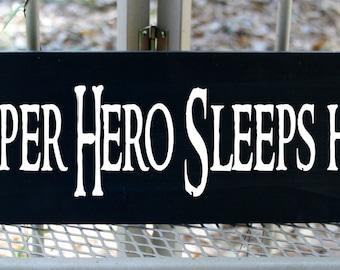 A super hero sleep here wood sign