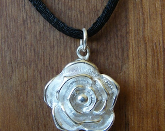Rose pendant of cast silver