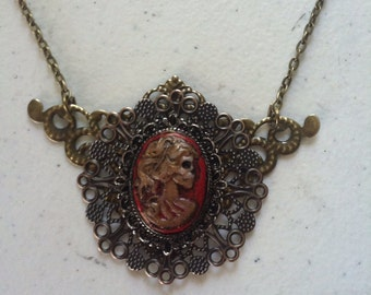 Sale~ Beautifully rotting skull lady cameo steampunk necklace