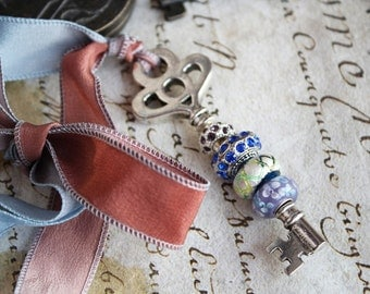 Key from the heart - a pendant on a silk ribbon hand-painted