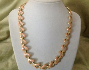 A Vintage Necklace that looks like the Breast Cancer Sign