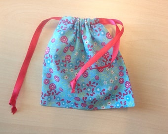 Handmade fabric pouch with satin ribbon
