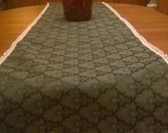 Green Table Runner with a Liittle Red in the Design Lace Bordered