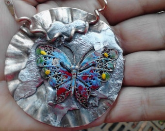 Unusual pendant!  All recycled materials.  Colorful and shiny!