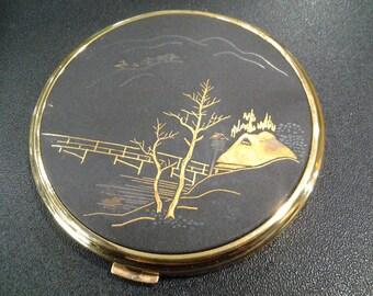 damascene gold plated compact