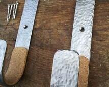 Set of two Custom hand hammered gun rack hooks.