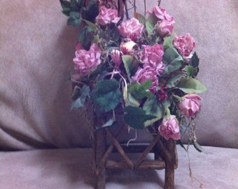 Roses and Birds Nesting On Chair