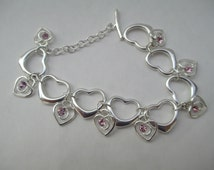 Sterling Heart Bracelet -Marked 9.25 with Pretty Metal Charms W/Pink Rhinestones - 7 1/2 inches with Toggle Clasp
