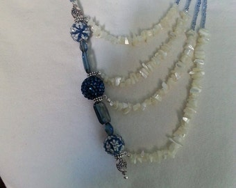 This necklace is off set for a dramatic look. The finished lenght is approximately 25 inches.