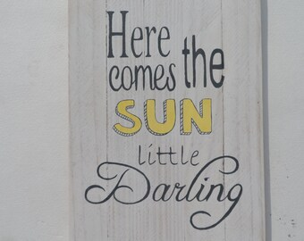 Here comes the sun little darling quote on a wooden sign. A great Beatles song and great decoration for the home! It sparkles in the light!