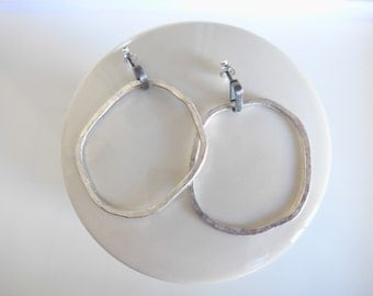 Earrings irregular organic hoops. sterling silver.