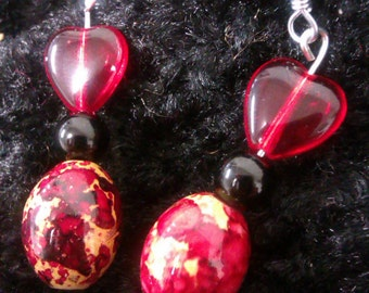 Red, gold and black heart earrings.