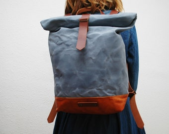waxed Canvas rucksack/backpack,  sky blue color, hand waxed , with handles, leather base and closures