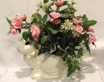 White bunny vase with pink mini roses.