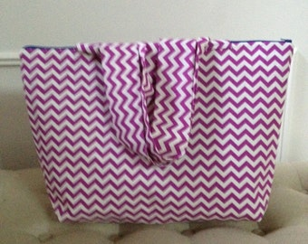 Beautiful; and sturdy tote bag  or makeup bag , has zipper and fully lined.Made in Sammamish, Washington
