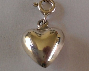 Handmade Solid 925 Sterling silver charm.