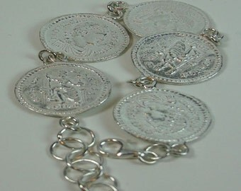 Silver bracelet with Roman coins.