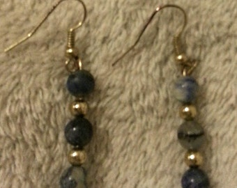 Handmade blue sodalite dangle earrings with gold toned accents