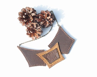 Brown leather necklace. Geometric necklace. Leather jewelry. Leather bib necklace. Brown and bronze necklace.