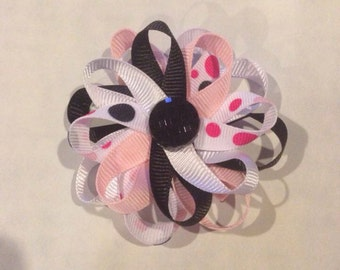 Pink, black, white, and polka dots multilayered bow