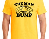 The Man Behind The Bump Mens Slogan TShirt Funny Fathers Day Baby Shower Gift Dad Humour Novelty New Dad To Be Present Pregnant Maternity