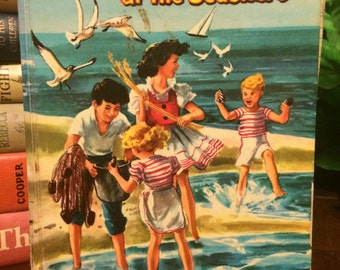 The Bobbsey Twins at the Seashore By Laura Lee Hope and Illustrated by Janet Laura Scott 1954