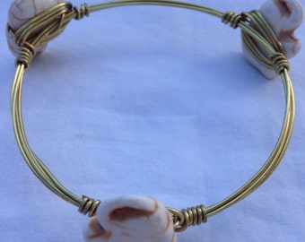 White elephants with gold/brown wire bracelet