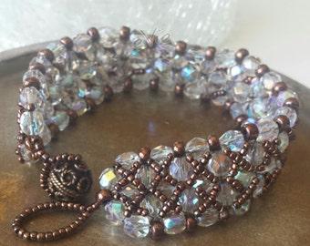 Beaded bracelet with embellishment