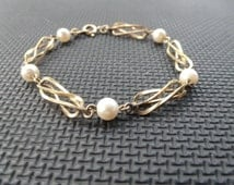 Tru-Kay bracelet, etched gold twists with pearls in between sections, signed with TK on hang tag.