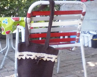 Chocolate brown lightweight crochet tote accessorized with knit trim