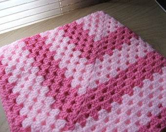Hand crocheted baby blanket. Pale and deep pink. Suitable for car seat, crib, pram or moses basket. Ideal just to wrap baby in.