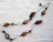 Long fire agate necklace with black beads, brown Swarovski bicones and sterling silver links. Brown necklace. Semiprecious stone.