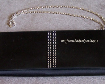 Evening bag of black satin with Rhinestone band, chain and internal mirror evening