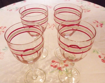 Vintage Set of 4 Red and White Banded Glasses by Hocking Glass Company.
