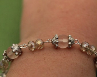 Pink and silver bead bracelet
