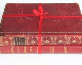 Pair of red leather bound antique books - decoration or ornament
