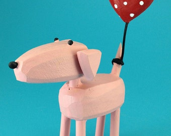 pink dog with heart balloon