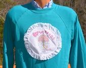 vintage 80s sweatshirt LOVE POURS applique raglan crewneck teal Medium wtf funny kawaii