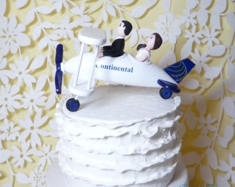 Plane wedding cake topper. Airplane, bride, and groom.