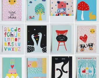 Large set of 14 different illustrated colorful postcards