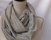 the INFINITY scarf in heather gray and metallic gold knit
