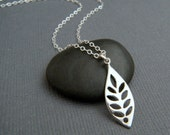 silver curved leaf necklace. small modern necklace. sterling silver. simple nature pendant. tiny single leaf. everyday dainty jewelry gift