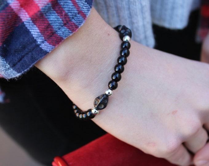 Silver and Black Skull Bracelet.
