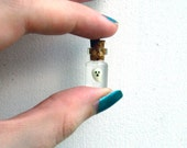 Tiny Glow-in-the-Dark Ghost in Tiny bottle charm/pendant