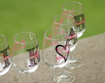 Bachelorette glasses.  Chevron monogram wine glasses.  Future mrs glass, bridesmaid glass.  Hot pink and black.  Title and date on the back