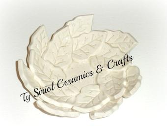 Ceramic leaf bowl in cream.