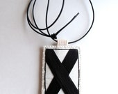 Valentines Day necklace double sided hand embroidered XO in black on cream muslin hanging from black leather cord hugs and kisses