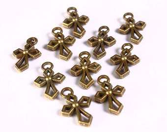 Petite cross charm pendant antique brass antique bronze - 17mm x 10mm (1296) - Flat rate shipping
