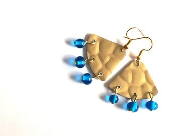 golden earrings with handblown blue glass beads