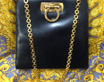 Vintage Salvatore Ferragamo black leather shoulder purse with gold tone chain from gancini collection. Classic bag from Ferragamo